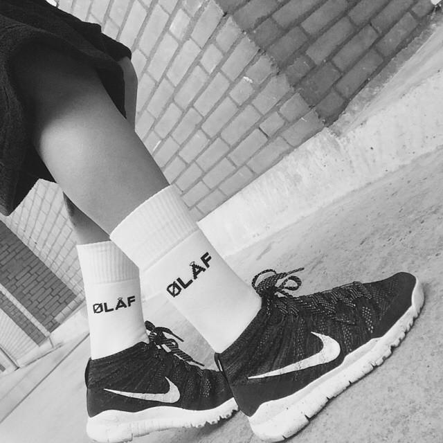 White Olaf Hussein socks in Nike